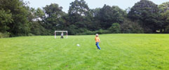Playing football in fields at Belsford holiday cottages
